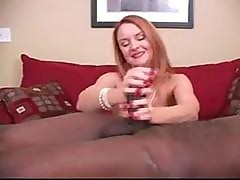 Redhead Is On The Casting Couch And Gives This Black Cock A Handjob